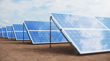 3D illustration Solar Panels. Alternative energy. Concept of renewable energy. Ecological, clean energy. Solar panels, photovoltaic with reflection beautiful blue sky. Solar panels in the desert Stock Photo