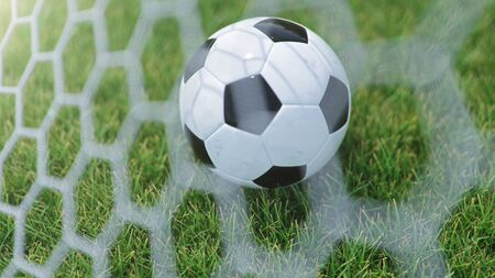 3D illustration Soccer ball flew into the goal. Soccer ball bends the net, against the background of grass. Soccer ball in goal net on grass background. A moment of delight