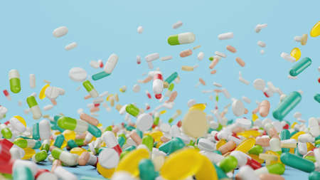 Falling different colored tablets, capsules on blue background. Health care concept. Antibiotics inside pills, vitamins. Product from pharmacy. Pharmaceutical company, industry, 3d illustration