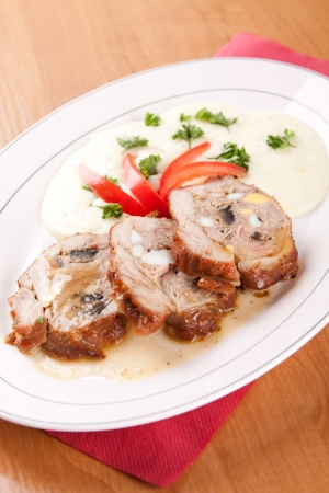 Veal roulade stuffed with minced meat and mashed potatoes photo