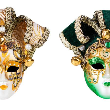 Dos máscaras venecianas aislados sobre fondo blanco Foto de archivo