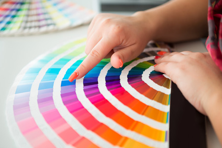printing press: Graphic designer working with pantone palette in studio