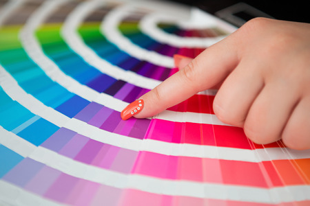 Graphic designer working with pantone palette in studio photo