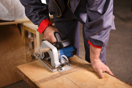 joiner: Hands carpenter working on the circular saw