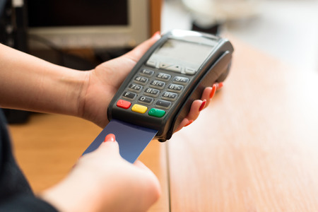electronic card: Woman pay by credit card in shop