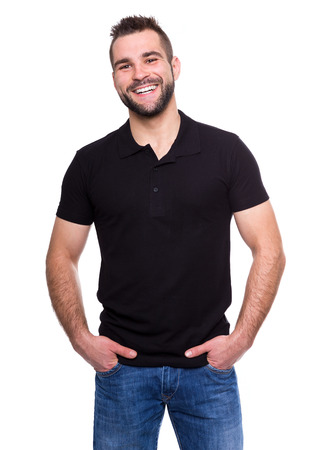 Young happy man in a black polo shirt on white background photo