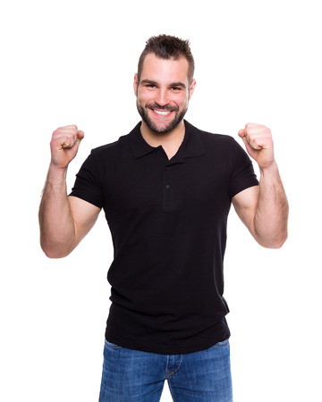 Young happy man in a black polo shirt on white background Imagens