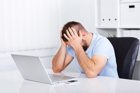 worried businessman: Young business man under stress with headache and migraine