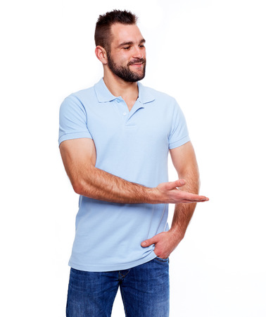 polo t shirt: Happy young man in polo shirt showing empty copyspace on white background Stock Photo