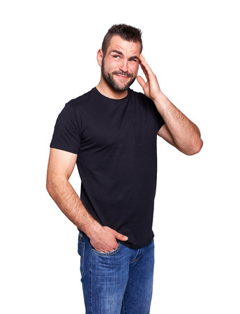 Young man squints eyes and can not remember on white background photo