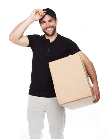 black  cap: Smiling delivery man giving cardbox on white background Stock Photo