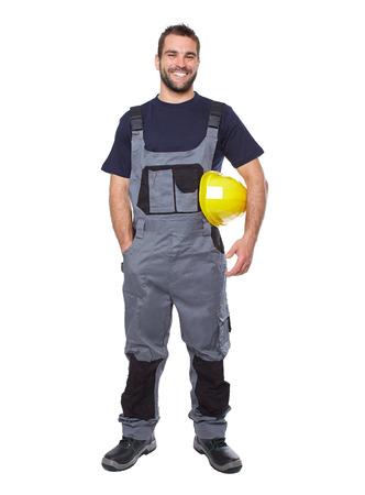 ouvrier: Portrait de travailleur en uniforme gris souriant isolé sur fond blanc