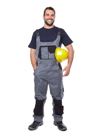 factory worker: Portrait of smiling worker in gray uniform isolated on white background