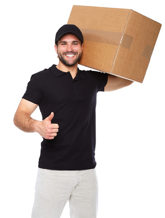 Smiling delivery man giving cardbox on white background Imagens