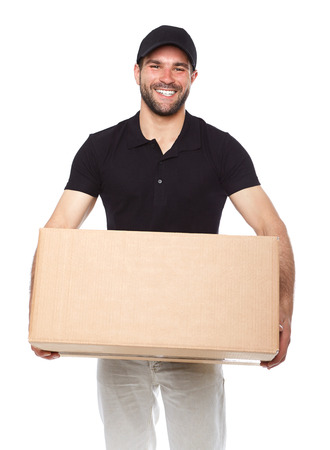 Smiling delivery man giving cardbox on white background Stock Photo