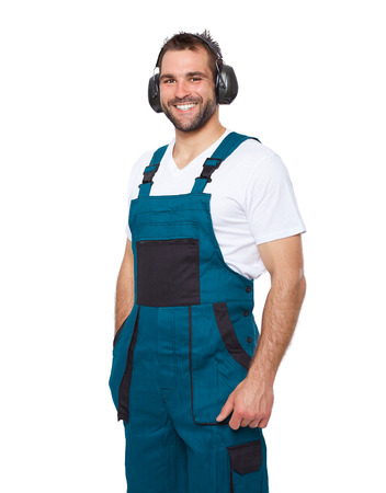 ear protection: Portrait of smiling worker in green uniform with protective earphones isolated on white background