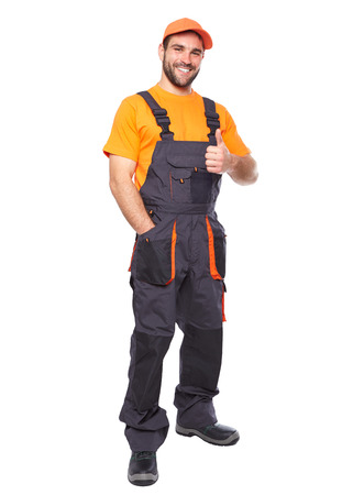 orange industry: Portrait of smiling worker in blue uniform with hands doing ok gesture isolated on white background  Stock Photo