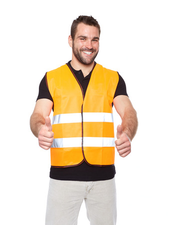 vest in isolated: Portrait of smiling worker in a reflective vest isolated on white background  Stock Photo
