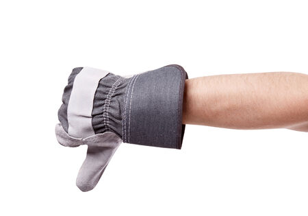 thumb down: Worker wearing leather work gloves giving thumbs down Stock Photo