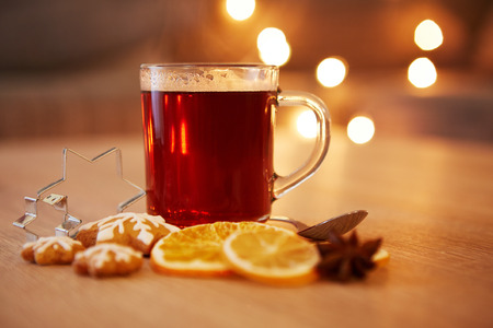 red tea: Hot christmas drink with spices and gingerbread, very shallow focus Stock Photo