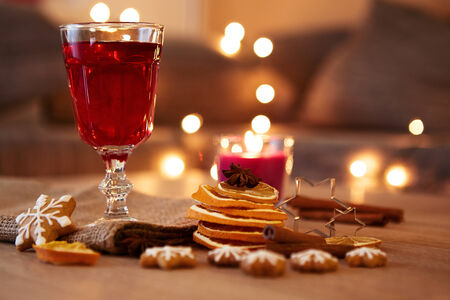 Glass of mulled wine with orange and spices, christmas decoration photo