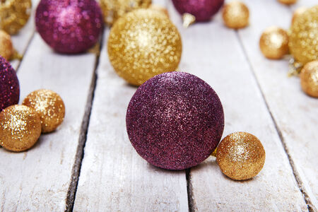 Christmas balls on white table close up photo