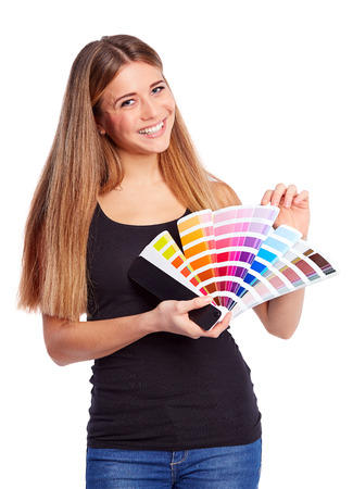 color swatch: Young girl holding color swatch, isolated on white background