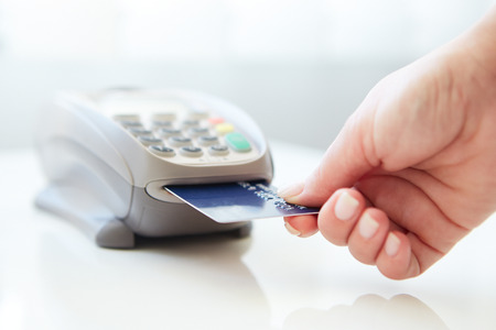 paying: Woman pay by credit card in store Stock Photo