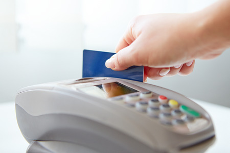 chip and pin: Woman pay by credit card in store Stock Photo