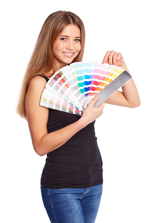Young girl holding color swatch, isolated on white background