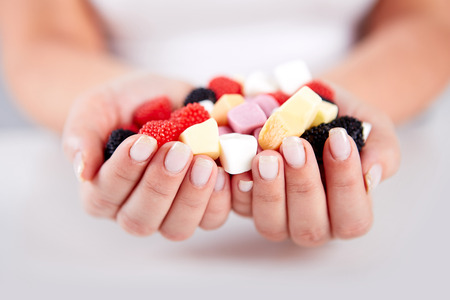 gummy: Woman hands holding a lot of candles Stock Photo