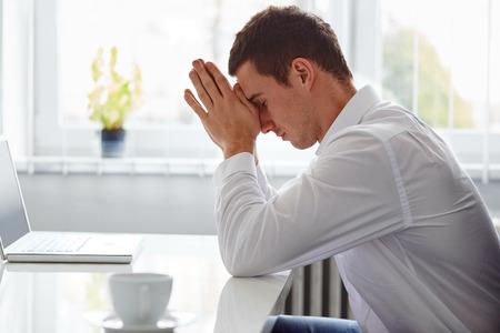 Young business man under stress with headache Reklamní fotografie - 40285314