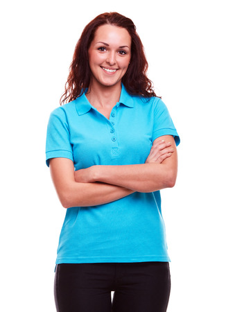 Smiling woman in blue polo shirt with arms crossed, on a white background Stockfoto