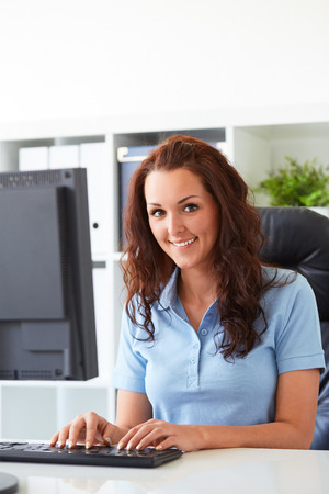charming business lady: Pretty business woman working in the office