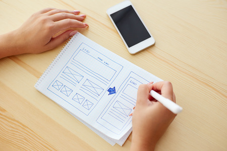 web design template: Woman sketching on paper design new website Stock Photo