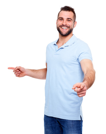 showing: Happy young man in polo shirt showing fingers