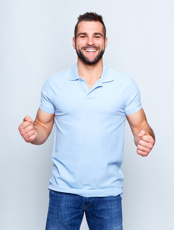 Young happy man in a blue polo shirt