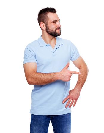 man shirt: Happy young man in polo shirt showing empty copyspace