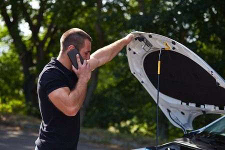 engines: Man with a broken car calling for assistance Stock Photo