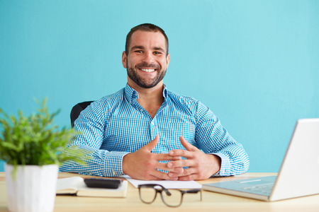 Young smiling businessman working in modern office