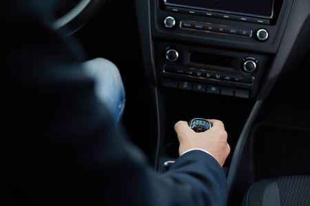 shifting: Hand of the driver on manual gear shift knob Stock Photo