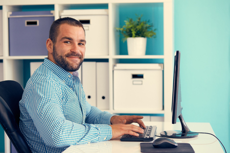 1: Businessman working in modern office on computer, toned Stock Photo