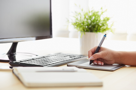 Graphic designer working on a digital tablet in office Stock Photo
