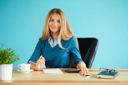 1 woman only: Young business woman with pen working in modern office