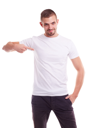 Young man showing empty copyspace on white t-shirt