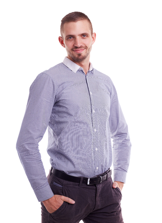 hands on pockets: Handsome man in a striped shirt with hands in pockets