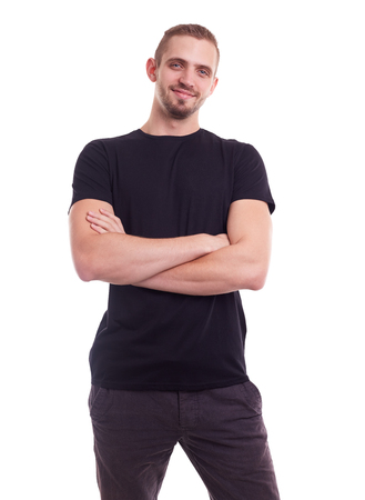 white t shirt: Young man in a black shirt with crossed arms