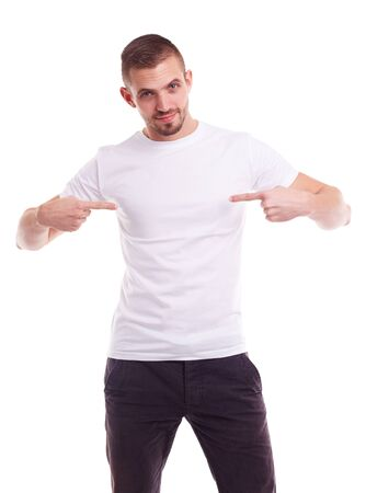 Handsome man showing empty copyspace on white t-shirt