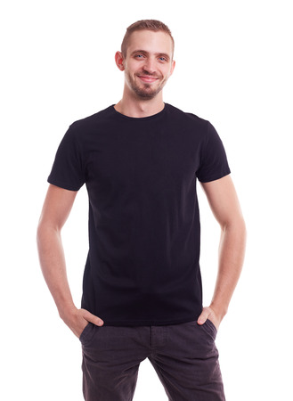 black t shirt: Young smiling man in a black t shirt on white background