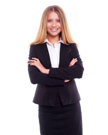 businesswoman suit: Young businesswoman in black suit standing with crossed arms, on white background Stock Photo